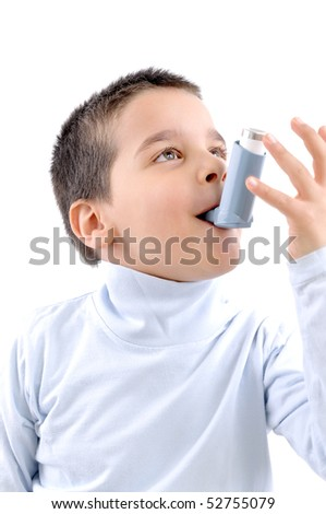 Close up image of a cute little boy using inhaler for asthma. White background MEDICAL related studio picture