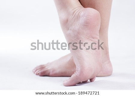 Close up image of a female feet. High key.