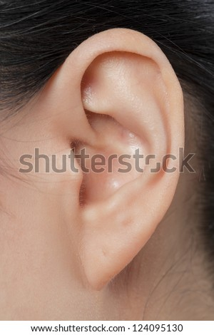 Close-up image of a female\'s left ear