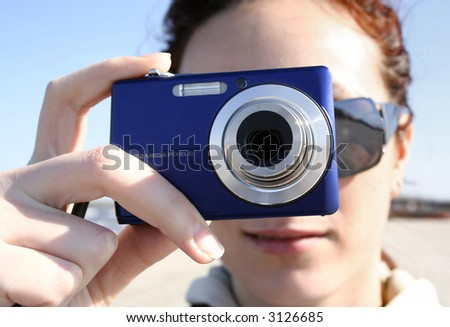 Close-up image of a girl who photograph the sea