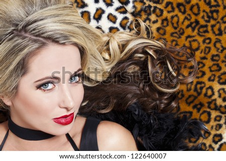 Close-up image of a gorgeous blonde female fashion model posing for the camera