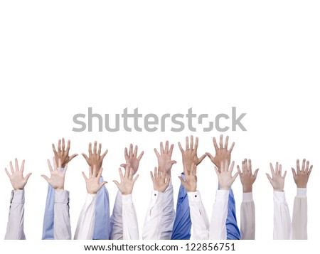 Close-up image of a group of hands reaching to the top isolated against the white background - stock photo