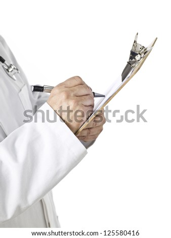 Close-up image of a hand of a doctor writing on the medical clipboard