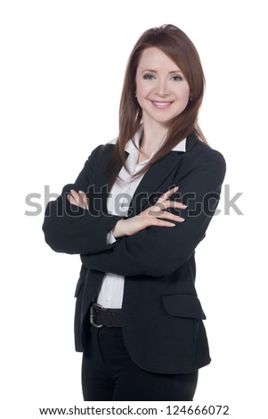 Close-up image of a happy businesswoman with arm crossed against the white surface