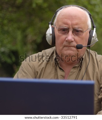 Close-up image of a senior using a laptop and voice call - stock photo
