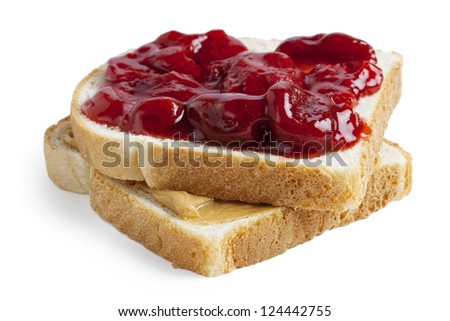 Close-up image of a slice of toasted bread with a spread of strawberry jam and peanut butter