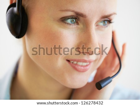 Close-up image of a smiling helpdesk operator consulting the client