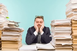 Close-up image of a stressful businessman tired from his work on the foreground - image
