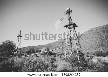 Close up image of a windpump / windpomp / in the great karoo region of south africa