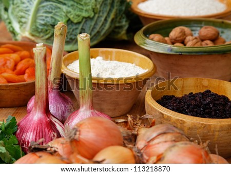 Close-up image of a wooden table full of natural food ingredients.