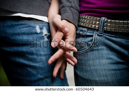 Close-up image of a young couple holding hands