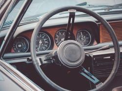 Close up image of an oldtimer car cockpit