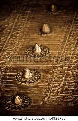 close-up image of ancient doors, very shallow focus