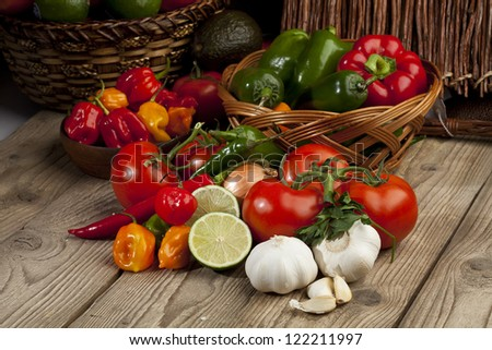 Close up image of assorted kinds of vegetable ingredients on wooden board