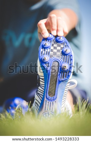 Close up image of athletic spikes shoes on an athletics track.