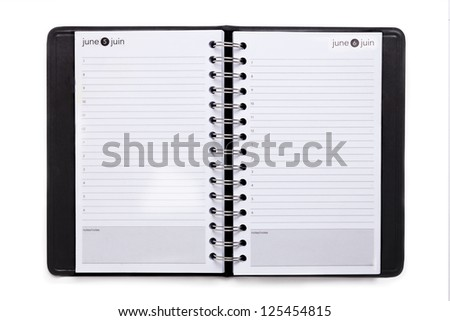 Close up image of black note book organizer against white background