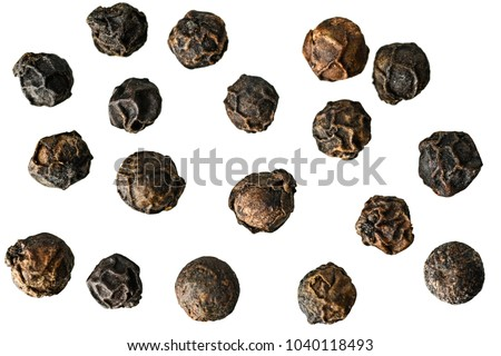 Close-up image of black pepper on white background, view above, no shadows