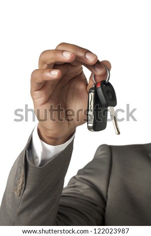 Close up image of businessman hand holding key against white background
