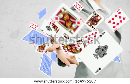 Close-up image of businesswoman throwing card deck