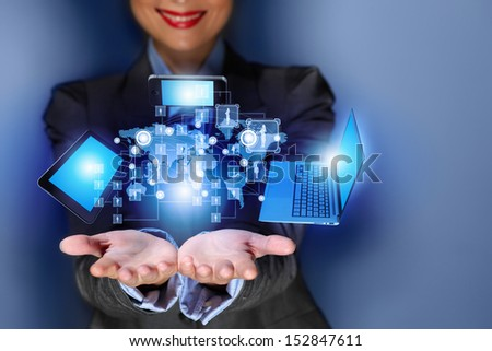 Close up image of businesswoman with 3d images of devices in her hands