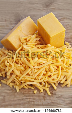 Close up image of cheddar cheese on wooden background
