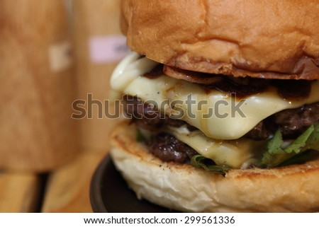 close up image of cheeseburger with becon