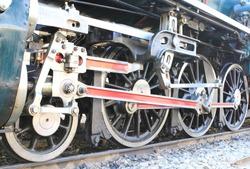 Close up image of classic steam locomotive wheel on