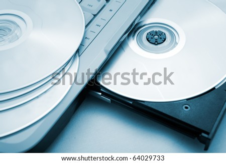 close up image of computer and cd and dvd