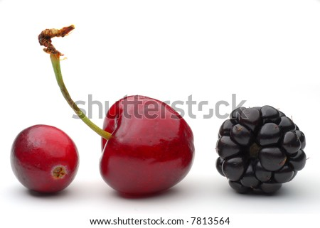 Close-up image of cranberry, cherry and blackberry isolated on white