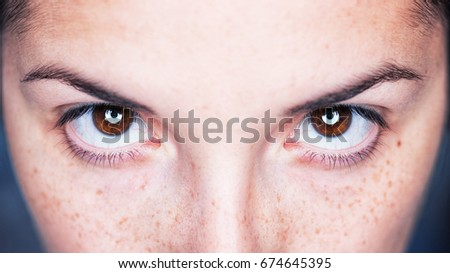 Close up image of female brown eyes - Intense magnetic look - Shutterstock ID 674645395