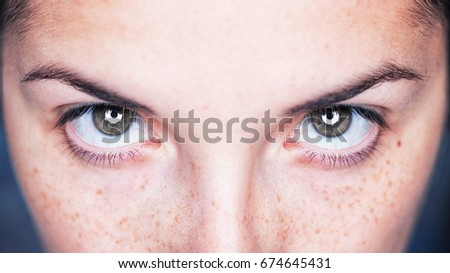 Close up image of female gray eyes - Intense magnetic look - Shutterstock ID 674645431