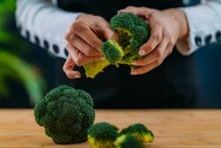 Close-up Image of fresh organic broccoli, superfood rich in vitamin K, vitamin C, folic acid, potassium, phytonutrients and fibers