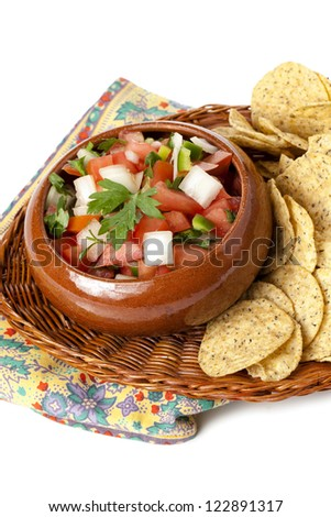 Close up image of fresh salsa dip with nacho chips