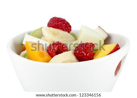 Close up image of fruit salad against white background