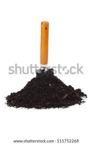 Close up image of garden shovel and soil against white background