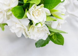 close up image of gardenias bouquet put on white fabric.