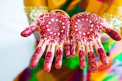 Close up image of henna on the Indian wedding bride.