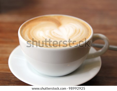 close up image of hot coffee and white cup on table