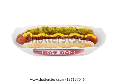 Close up image of hot dog sandwich in paper tray against white background