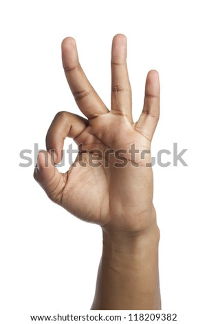 Close-up image of human hand counting three over the white background