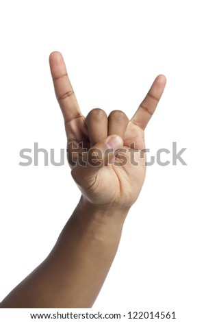 Close up image of human hand gesturing a rock and roll sign against white background