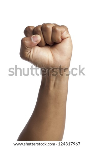 Close-up image of human hand with closed fists against the white surface