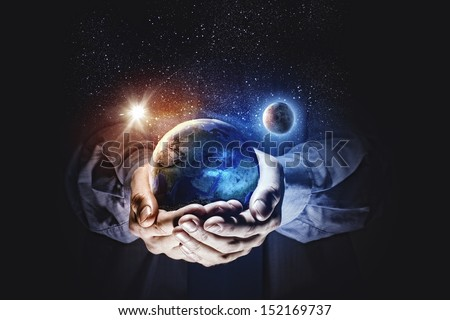 Close up image of human hands holding earth planer. Ecology concept. Elements of this image are furnished by NASA