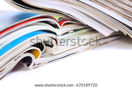 Close up image of magazines stack background. News and media publications. Magazines heap detail