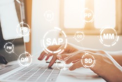 Close-up image of male hands working on laptop. Business management software (SAP). ERP enterprise resources planning system concept