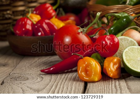 Close up image of mexican vegetables ingredients on wooden table