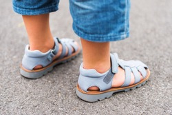 Close up image of new beautiful kids shoes on child's feet