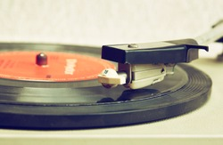 close up image of old record player,  retro filtered . selective focus