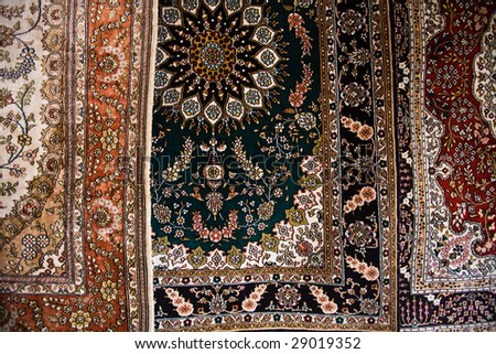 Close up image of 3 ornate Persian style carpets made in Kashgar China