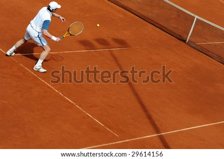 Close up image of player on a tennis court
